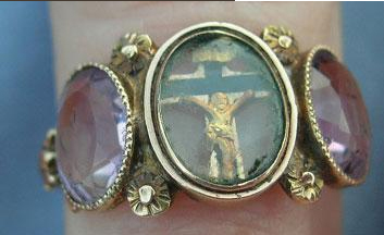 Faith, hope, charity ring depicting crucified Jesus