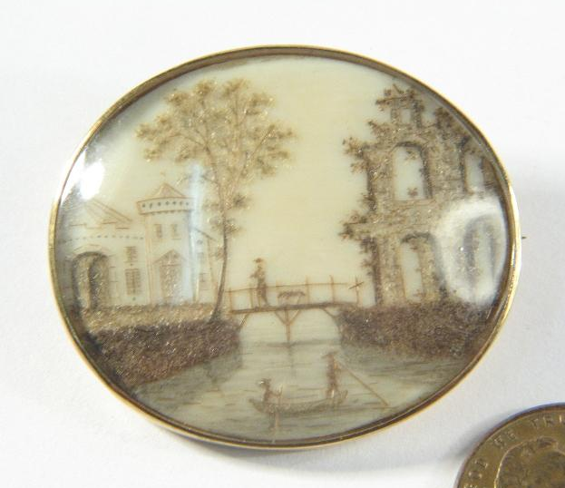 Neoclassical Brooch with castle and river crossing