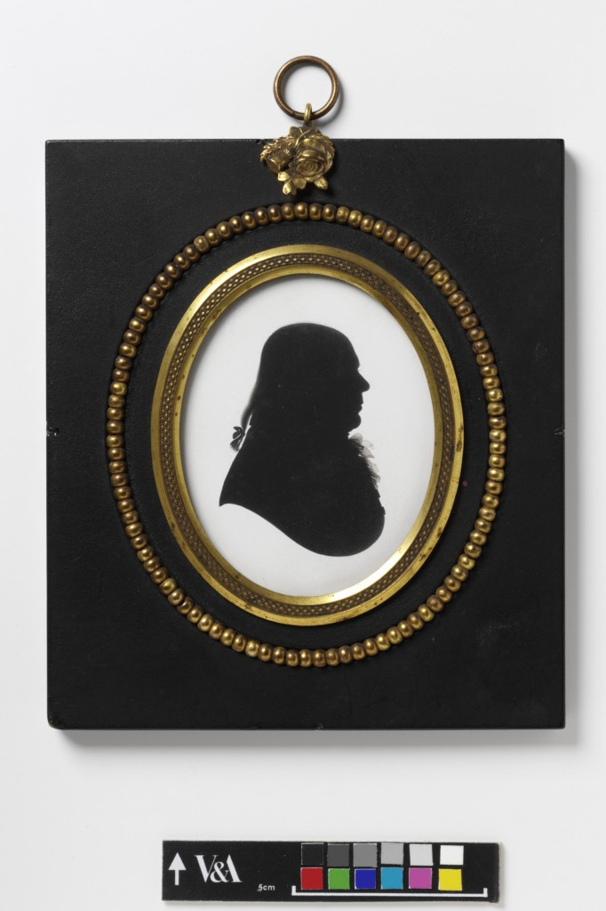 Silhouette portrait, painted in black on plaster, depicting William Bray, the Surrey antiquarian. On the reverse is an engraved trade label of Miers with the sitter's name faintly inscribed.