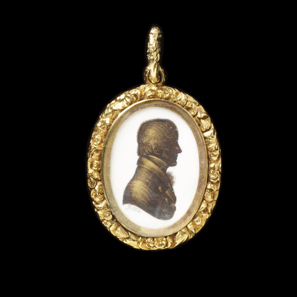 Gold, cast and chased shellwork and floral frame enclosing a silhouette of a gentleman painted in watercolour on ivory by John Miers; mounted on the reverse with a curl of hair bound with gold thread and pearls.