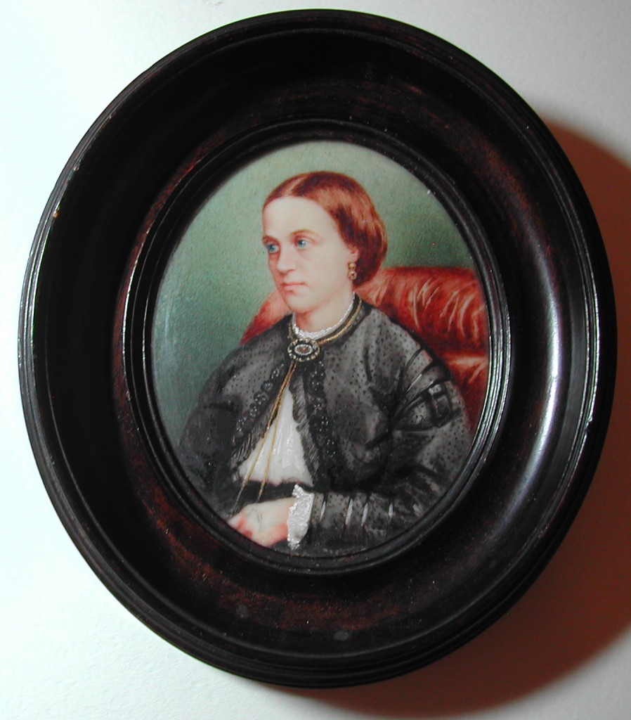 mourning brooch seen on the neck of a woman in a miniature, mid 19th century