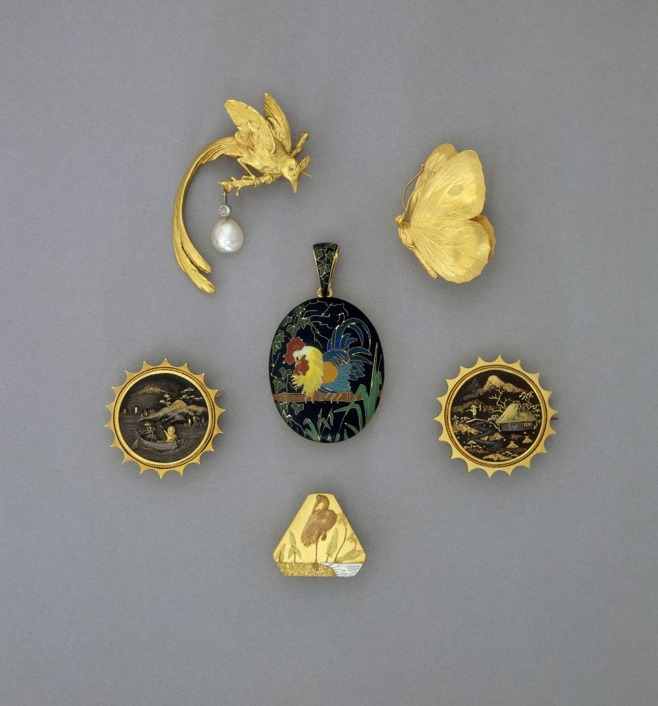 Chased gold brooch in the form of a butterfly with folded wings. Warranty mark and illegible maker's mark. Image top right.