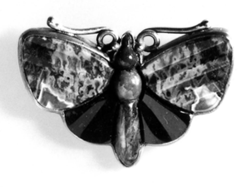 Silver brooch set with jasper, agate and bloodstone in the form of a butterfly.