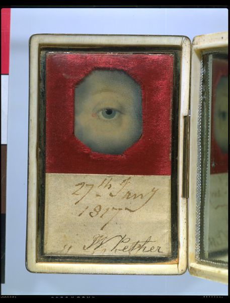 "Eye miniature set inside the lid of an oblong ivory case, embedded in red velvet, with a piece of paper inscribed ""27th Jan'y 1817. W Pether"". A mirror is set inside the opposite half the case."