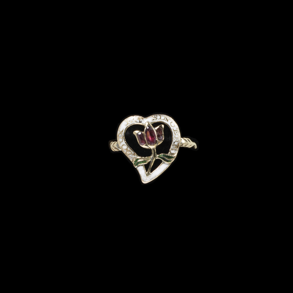 Enamelled gold giardinetti ring with a bezel in the form of a pierced heart inscribed 'DOUX ET SINCERE', framing a tulip set with garnets