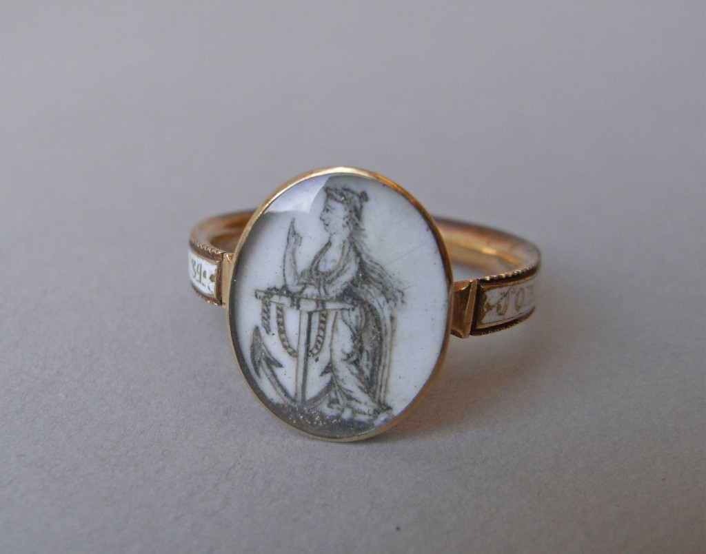 DescriptionMourning ring; gold; oval bezel with figure of Hope leaning on an anchor, painted in outline on white enamel and reinforced with hair-work; inscription on white enamel. No maker's mark.