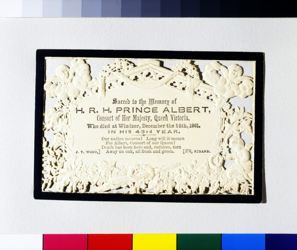 memorial card. It has the black painted border which commonly occurred on a wide range of stationary during a period of mourning. The relief images have been created by embossing and piercing the paper, that is die-stamping the dampened paper.