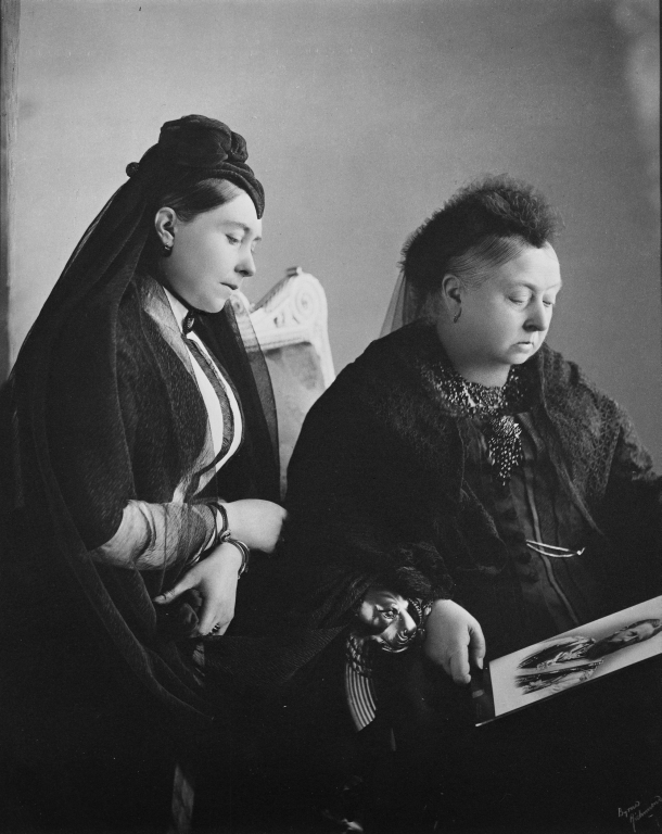 Photograph of Queen Victoria (1819-1901) with Empress Frederick (1840-1901) both wearing black in mourning holding a photograph of Emperor Frederick III who died in June 1888
