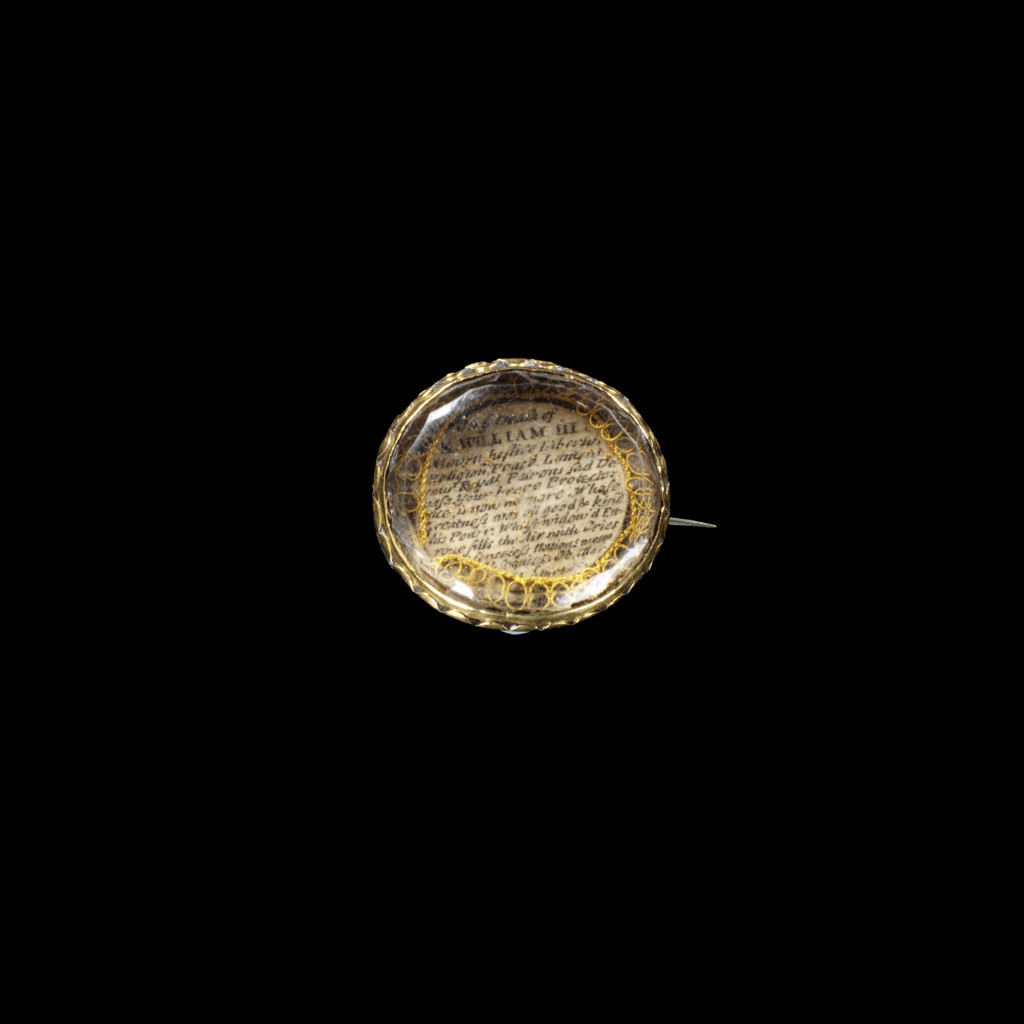 Gold with paper or vellum, iron gall ink, gold wire and glass