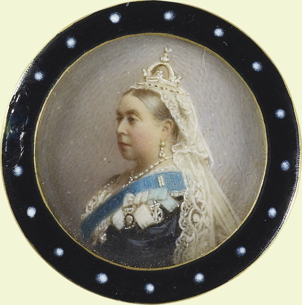 A gold mourning brooch with black and white enamel frame set with circular miniature of Queen Victoria wearing the riband of the Order of the Garter
