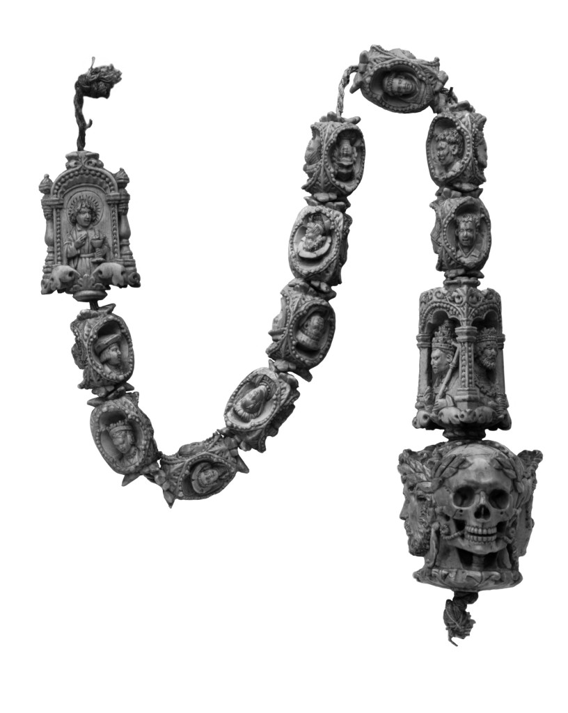 This is an ivory chaplet made in France or South Netherlands in about 1530. The beads are carved with figures of the Virgin Mary and St John the Evangelist, the joined heads of a man, woman and Death, and images of the Pope, kings and figures in aristocratic dress. The Italianate ornament in which these images are set is characteristic of the style considered fashionable by sophisticated French purchases of such luxury items around 1550. Considered all together the beads constitute a sculptural equivalent of the Office of the Dead found in contemporary Books of Hours, and indeed the extensive choice of figures, including the fool and what may be taken as members of the various ecclesiastical, courtly and professional hierarchies, echoes that found in the margins of Philippe Pigouchet's Book of Hours of the late 1490s. In the Late Middle Ages the chaplet was a vital and commonplace aid to keeping count of the repetition of prayers for both rich and poor. Often hung from the belt by a ring, it usually consisted of ten 'ave' (Hail Mary) beads with a larger 'paternoster' (Our Father) bead at the beginning or end and a terminal Crucifix. Chaplet beads were made in many materials, from humble plain wood to precious metals and ivory. The popularity of the rosary – the fullest form of repeated prayers – gave rise to the establishment of confraternities devoted to its use in the late fifteenth century, so that by the sixteenth century the production of intricate and costly chaplets was widespread. Chaplets often ended not with a cross but with a terminal pendant, and it is these larger beads which are usually the grandest. Most of them are connected with the notion of the memento mori, a constant reflection that human life is transient. The most common type of memento mori bead is that with conjoined heads: the skull, representing Death, is always present, and is either backed with a single bust or a pair of heads, male and female. The depiction of the skull often allowed the carver's imagination full rein, with toads, worms and lizards crawling in and out of the mouth and eye sockets.