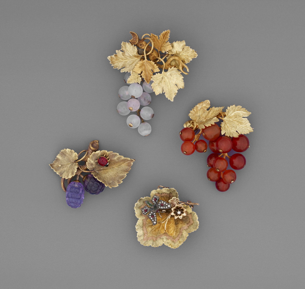 Chased two-colour gold brooch set with carved amethysts in the form of a fruiting mulberry with an enamelled gold ladybird on one leaf. The mulberries are carved on the upper side only.