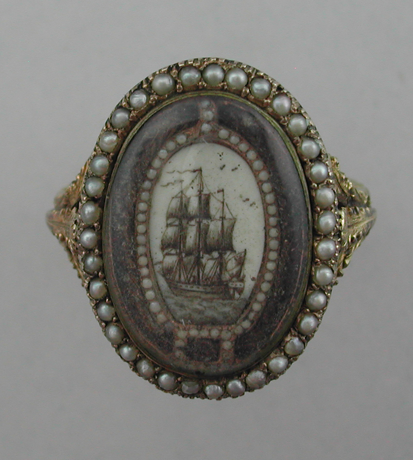 Mourning ring dedicated to First Earl of Winterton, Edward Turnour and née Armstrong showing sepia painted ship sailing into the distance. Garter motif, hair and pearls surround.