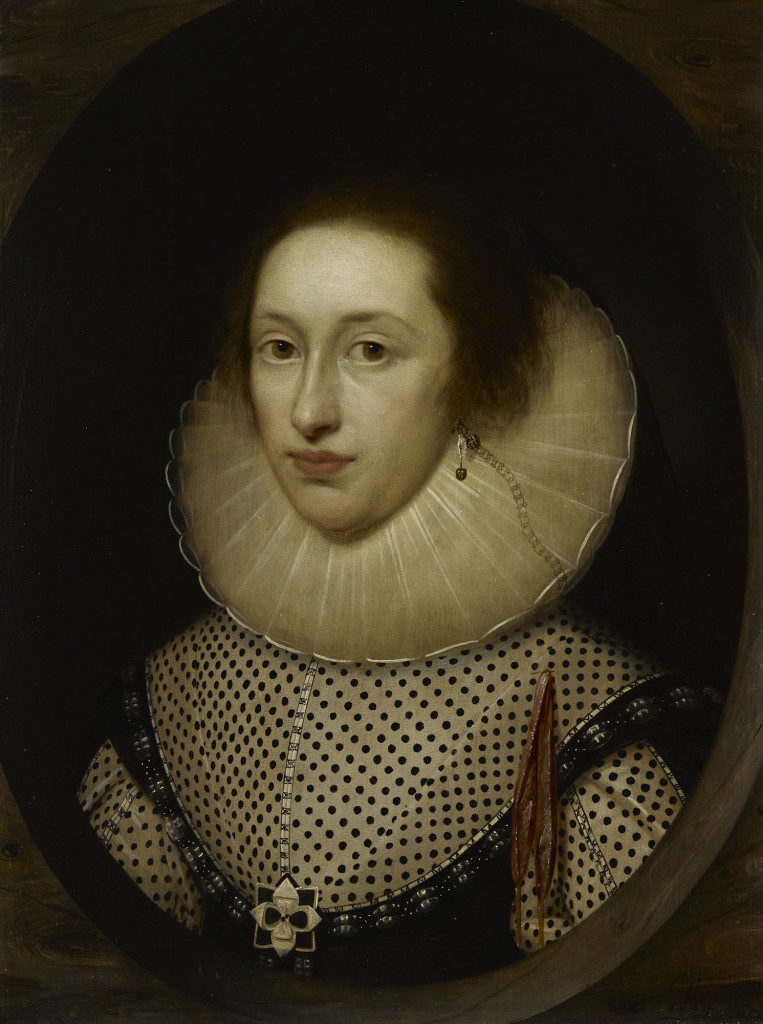 The small scale of this picture, in between a life-size portrait and a miniature is unusual, although there are other instances by this artist. As is typical in the work of Cornelius Johnson, the sitter's costume is depicted in seemingly accurate and painstaking detail. The unidentified sitter in this enigmatic portrait is possibly in mourning for a loved one. The matt black fabrics seen here would have been considered appropriate at such a time. Near her heart is pinned a ribbon point, usually used to lace garments together, which is perhaps worn as a love token. Her earring is very unusual, consisting of a selection of pendants (including praying hands) and a fine chain reaching to her shoulder.