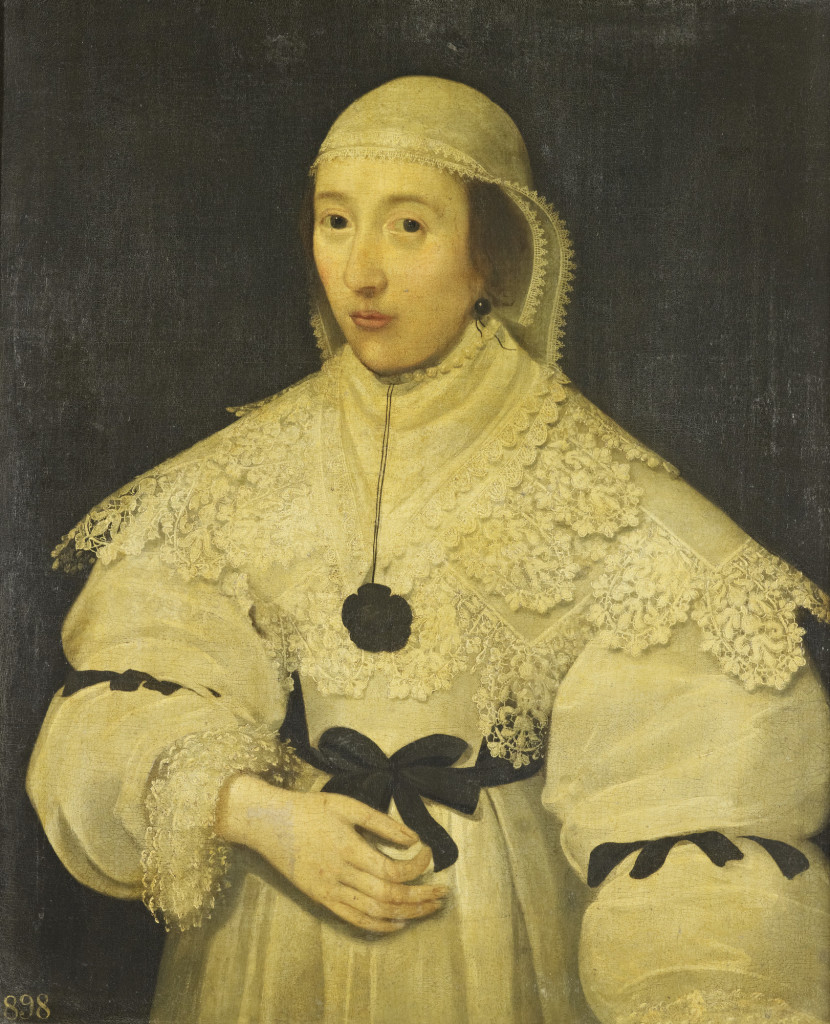 Half-length portrait of a woman, facing half to the left, apparently wearing mourning dress. She wears a white bodice and skirt, decorated with multiple layers of lace and black ribbons. Her head is covered by a two-layered veil of transparent linen trimmed with lace. Provenance Probably purchased by Frederick, Prince of Wales as part of the collection of early portraits, formerly in the collection of Lady Capel, which were acquired at Kew. Recorded at Kensington in 1818.