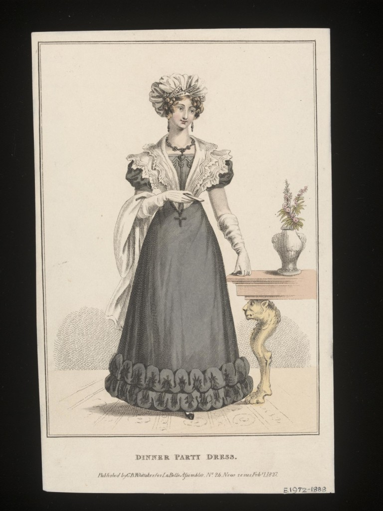 c.1827 A lady wearing a black (mourning) dinner party dress with flower and chevron detailing at the top of the bodice, lace collar and bunching around the hem. She is wearing white gloves and a turban, and carrying a shawl. To her left stands a table with grotesque leg comprising a lions head and paw. A vase of flowers stands on top of the table.