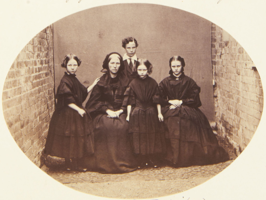 Photograph of a group that includes the children of the Jager McDonald. From left to right: Helena, standing with her left arm on her mother, Mrs McDonald seated; George who stands behind his mother; Caroline standing facing the viewer and Annie (1848-66?) seated facing the viewer. Provenance Acquired by Queen Victoria