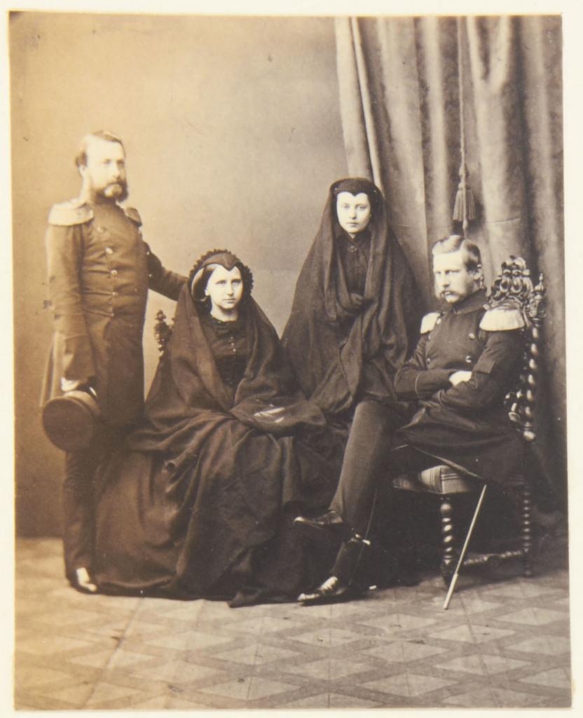 Photograph of a group that includes Frederick, Grand Duke of Baden (1826-1907); Louise, Grand Duchess of Baden (1838-1923); Friedrich, the Crown Prince of Prussia (1858-88) and Victoria, Crown Princess of Prussia (1840-1901). The group wear mourning dress for King Frederick William IV of Prussia. Provenance Acquired by Queen Victoria