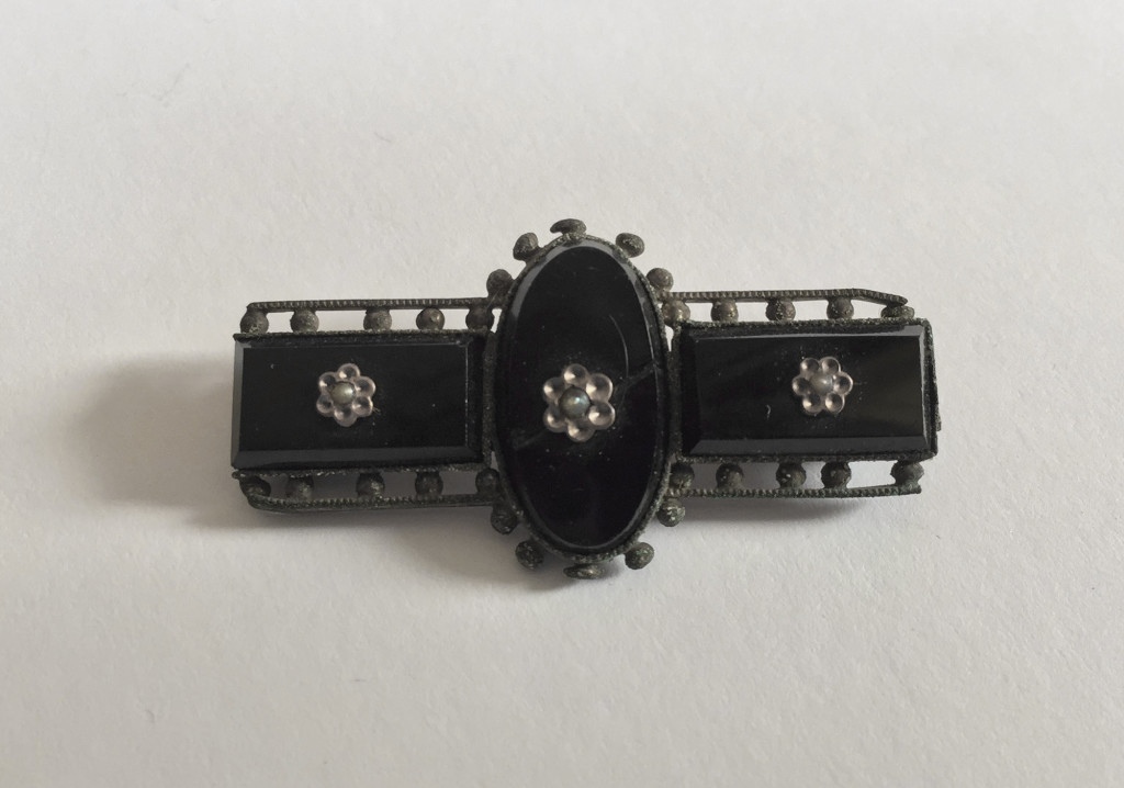 Onyx and silver brooch
