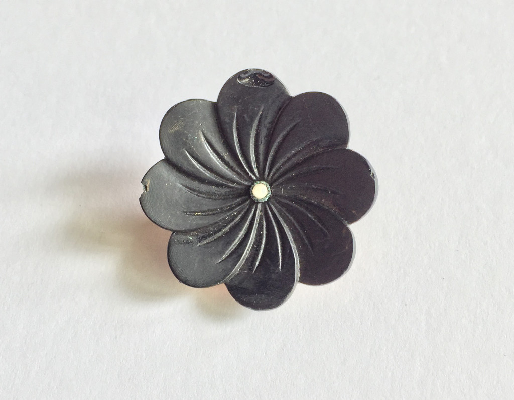 Vulcanite flower pin
