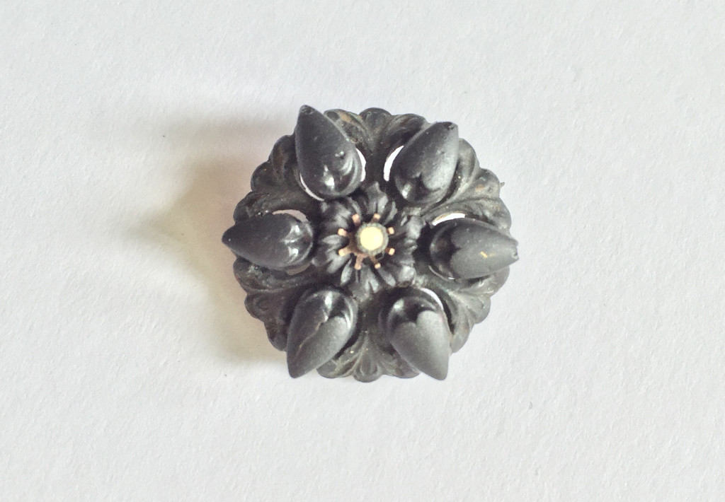 Floral, vulcanite brooch