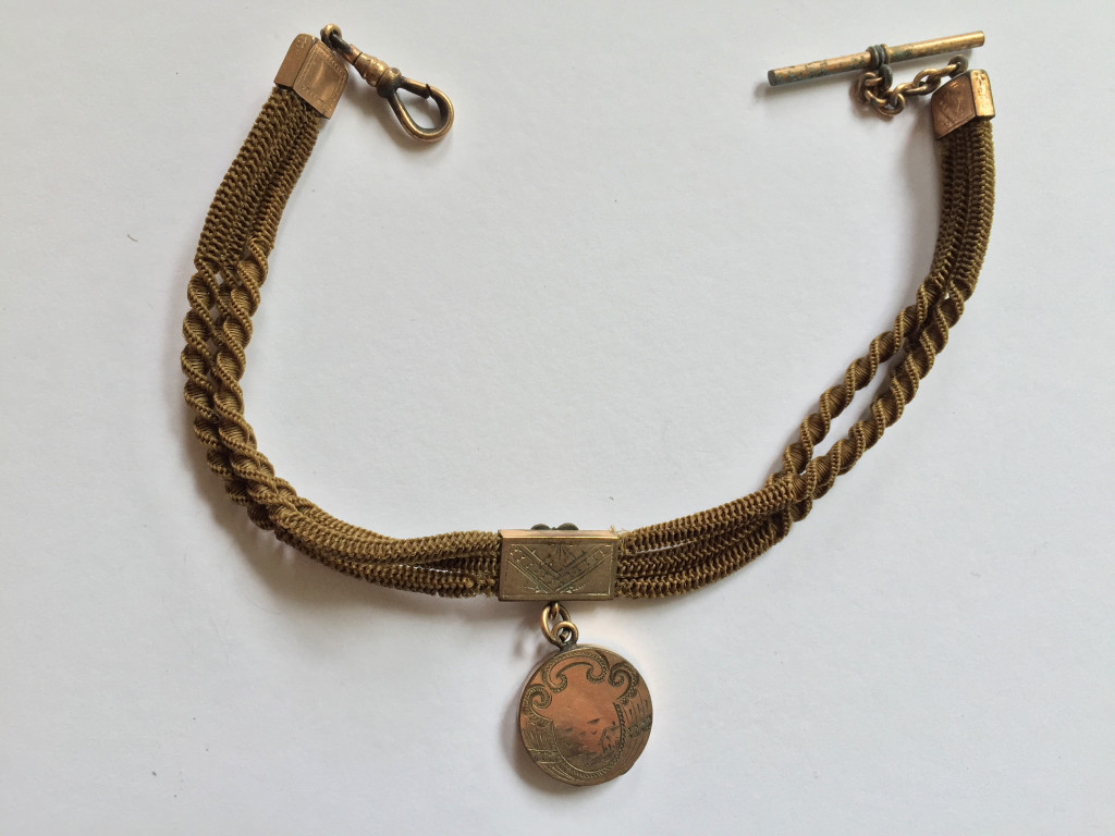 Reverse of blonde fob hair chain, with I initial and photograph, c.1890