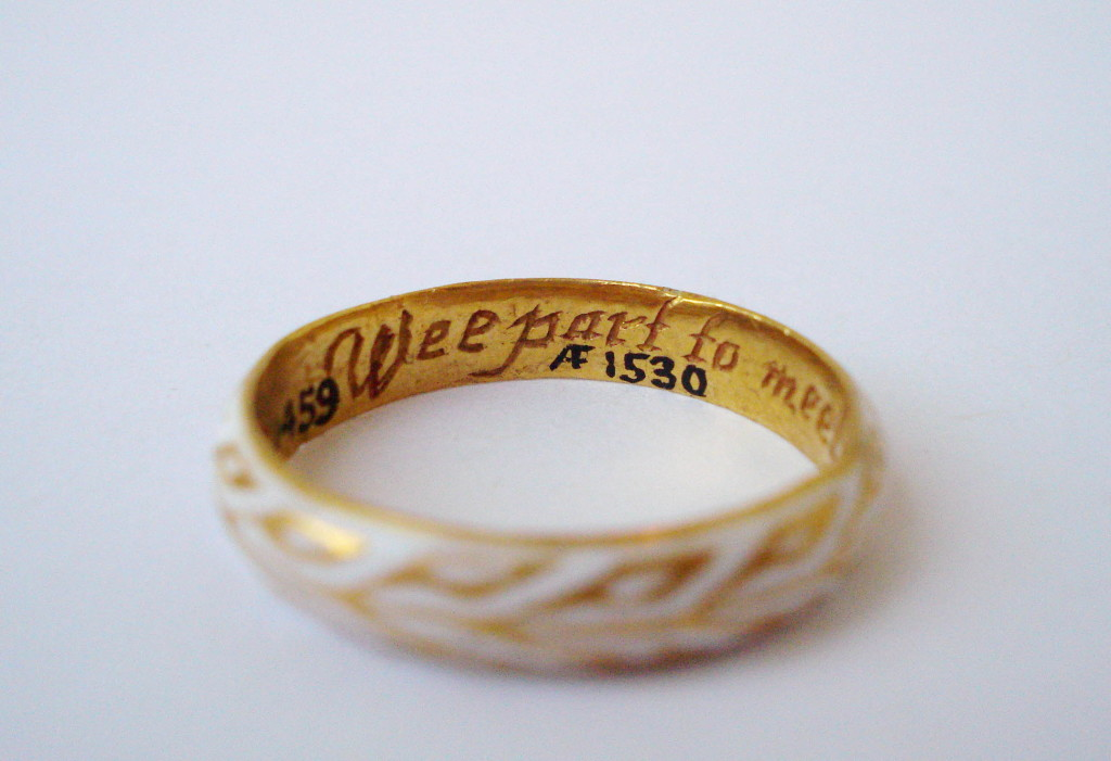 Mourning-ring; gold; hoop has, on outer side, laurel wreath reserved on ground of white enamel; in place of bezel is outline of skull; inscribed.