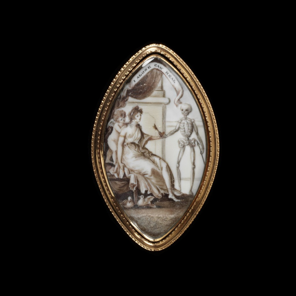 Engraved gold frame, ivory painted in watercolour with a miniature of a woman handing a heart pierced by an arrow to a figure of Death, surmounted by an inscription I ALONE CAN HEAL The back of plaited hair crossed by the name Fergusson on paper.