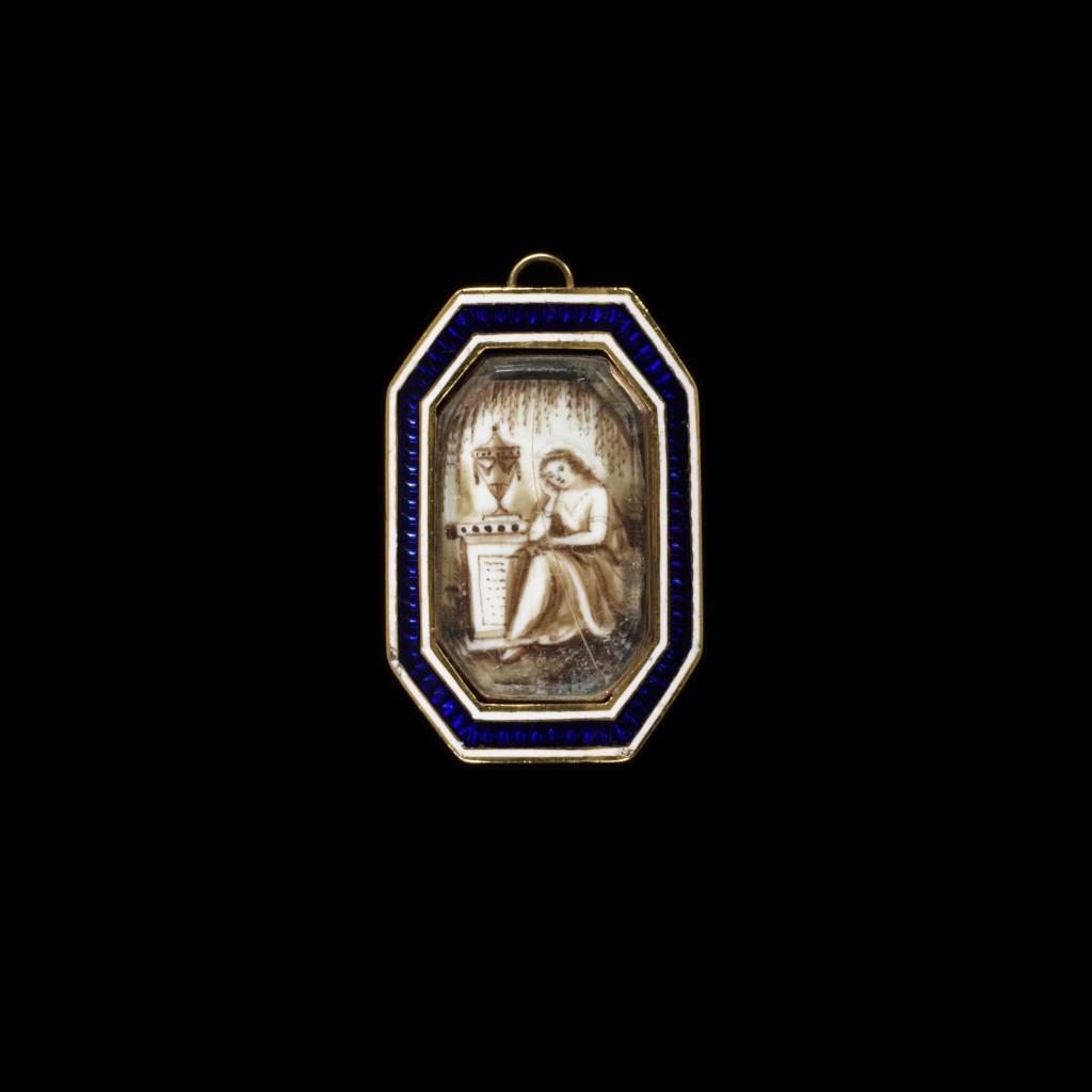 Gold brooch or pin with an enamelled gold frame, ivory painted in watercolour with a miniature of a woman seated by a tomb beneath a willow with hair in design