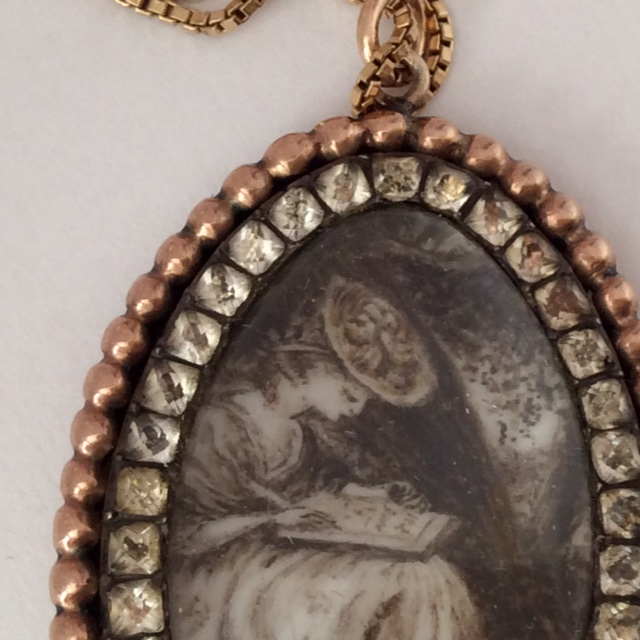Sepia miniature pendant, depicting a fashionable lady writing , c.1780s