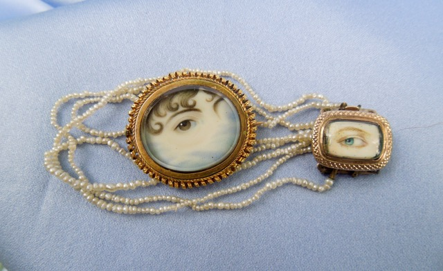 Eye portrait collection with clasp and brooch. Seed pearl strings.