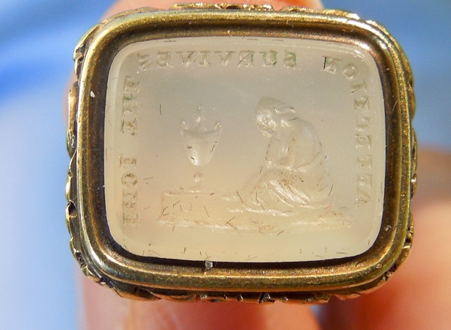 "Fob intaglio reading ""Affection survives the Tomb""."