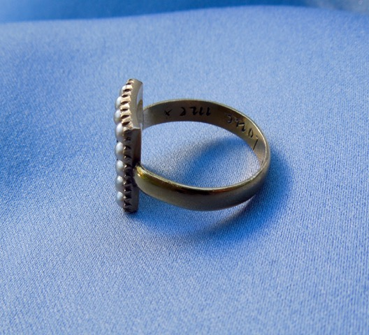 "Side of posie ring with later conversion, reading ""Fear God Love me""."