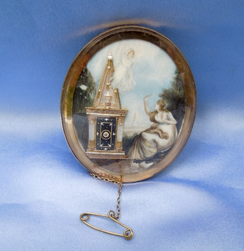 Colour miniature of a child flying off to heaven with the mother looking on. Features a 3D tomb in ivory and pearl.