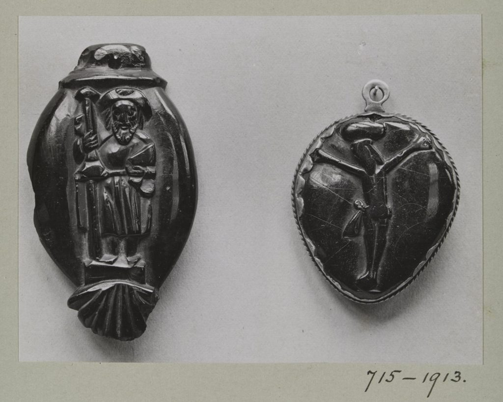Jet bead of St James the Greater and a jet pendant of the crucifixion, c.1520-1650 and c.1600-1700.