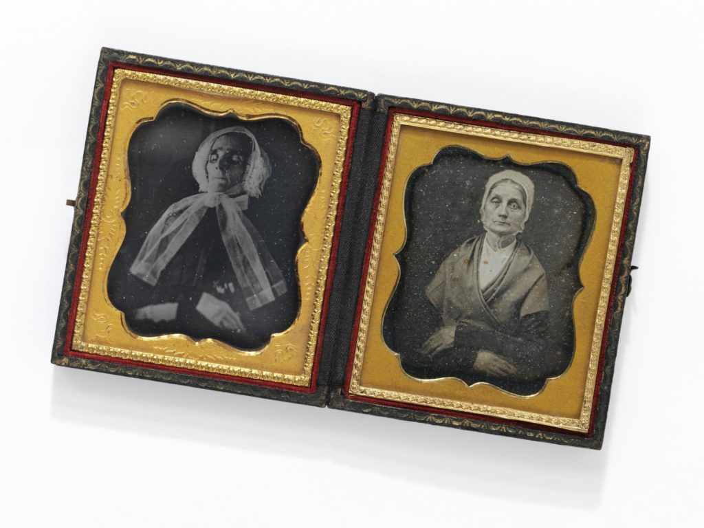 """The unusual example of the 'double portrait', housed in one case of the elderly woman alive and deceased makes a powerful comparative pairing. The subject's resting pose of her crossed hands in the life portrait is intentionally and aptly echoed in the post mortem image."" - V&A Museum"