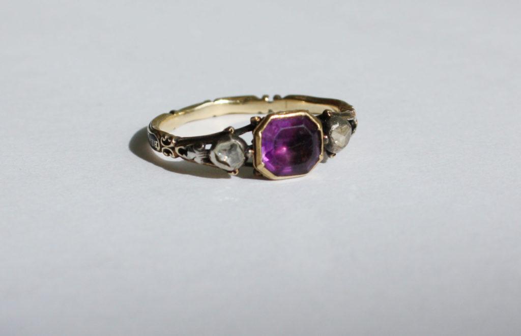 Mourning ring dedicated to Rev John Wright OB 20 Feb 1715. Black enamel, amethyst.