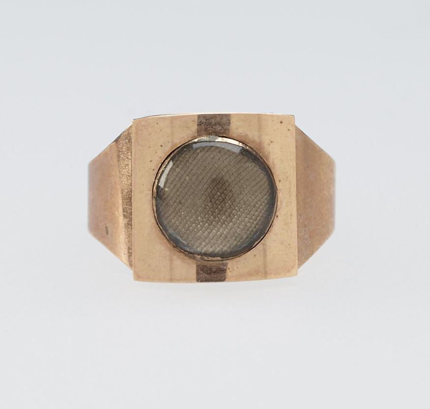 """Early 19th century ring, courtesy the Royal Collection: """"A plain rose gold ring with square top set with panel of woven hair behind glass."""""""
