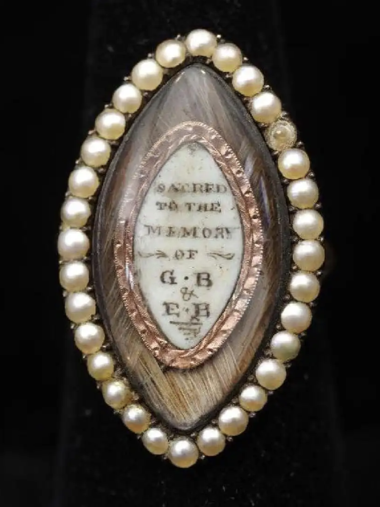 "Mourning ring with dedication; ""Sacred to the memory of E.B & G.B"" Reverse: ""Reverend G. Bally Rector of Monxton O.B Jan 18 1779 A.E 59""."